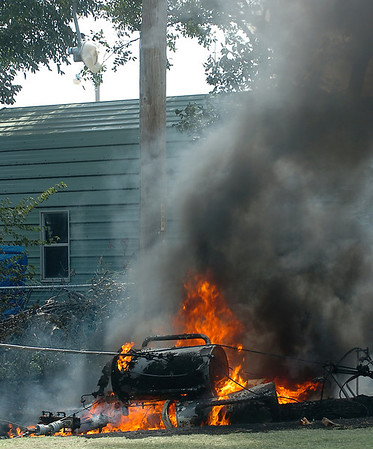A transformer burns after falling from a utility pole Monday in the 900 block of south 2nd street. (Staff Photo by BILLY HEFTON)