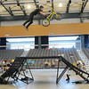 A BMX cyclist a trick during the Monster BMX Jam Saturday inside the Enid Event Center. (Staff Photo by BILLY HEFTON)