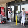 Jumbo Foods'  employee,  James Fuchs, tells a patron the store in Willow West Plaza will be closed while the cause of an electrical fire is investigated Tuesday, August 6, 2013. The store was evacuated for the safety of the customers and employees. (Staff Photo by BONNIE VCULEK)