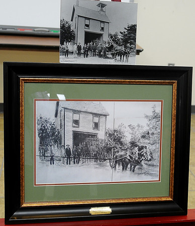 Artist Duron Lewis's pencil drawing of the Enid Firehouse from 1906 at the corner of Grand and Maine was presented to City of Enid officials, Enid Fire Chief Joe Jackson and the Enid Fire Department at Central Station Thursday, August 22, 2013. (Staff Photo by BONNIE VCULEK)