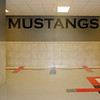 """When student enter the south entrance to Longfellow Middle School, giant """"MUSTANGS"""" lettering will greet them. Hallway renovations include beautiful flooring, tiled walls, new water fountains and restroom facilities. (Staff Photo by BONNIE VCULEK)"""