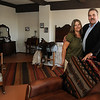 "Dana and Johnny Peart pause inside the ""Old Enid Suite"" on the fourth floor of Broadway Tower. Peart, who purchased the downtown landmark, has remodeled part of the 114 E. Broadway Ave. property which will feature 72 rooms and suites on floors 2-9, the Broadway Cafe & Lounge and the DinEnid Eatery. The Grand Opening of the tower will be from 6-9 during First Friday festivities tonight. (Staff Photo by BONNIE VCULEK)"