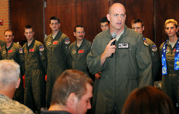 Col. Darren James, Commander of the 71st Flying Training Wing at Vance Air Force Base, congratulates the members of Class 13-13 during aircraft assignment festivities Friday, August 2, 2013. (Staff Photo by BONNIE VCULEK)