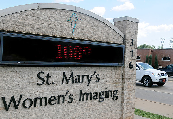 As traffic passes St. Mary's Women's Imaging at 316 W. Owen K. Garriott, the temperature on the marquee reads 108 degrees at 3:17 p.m. Friday, August 30, 2013. Other digital displays registered 101-105 around Enid Friday afternoon. Temperatures are expected to reach 105 Saturday with a chance of rain Sunday. (Staff Photo by BONNIE VCULEK)