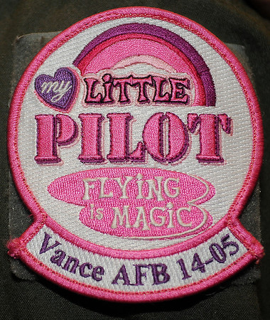 """A member of the pilot training Class 14-05 wears his pink, """"My Little Pilot"""" patch at Vance Air Force Base Friday, August 2, 2013. (Staff Photo by BONNIE VCULEK)"""