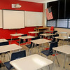 Beautiful classrooms at Longfellow Middle School have a new smartboard and projector surrounded by white board spaces against a bright red wall, larger desks, new flooring and automatic lighting features. (Staff Photo by BONNIE VCULEK)