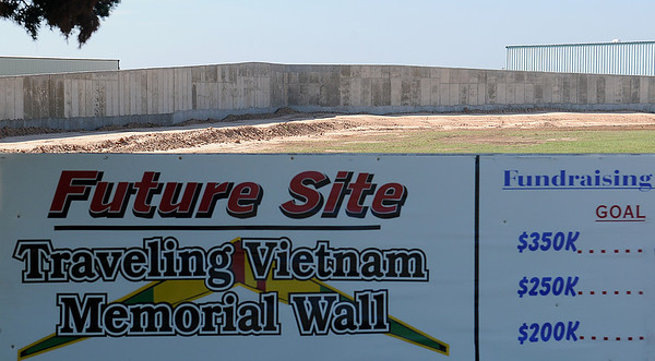 Construction of the permanent site of the retired Traveling Vietnam Memorial Wall continues at Enid Woodring Regional Airport. Grass will be installed as soon as the rain-soaked soil can be leveled. Approximately $45,000 is still needed for the completion of the project. (Staff Photo by BONNIE VCULEK)
