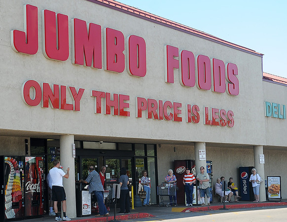 Jumbo Foods customers wait outside the business after the store was evacuated during an electrical fire Tuesday, August 6, 2013. Jumbo Foods employees were allowed to return to work, but the store remained closed until the electrical issues could be resolved. (Staff Photo by BONNIE VCULEK)