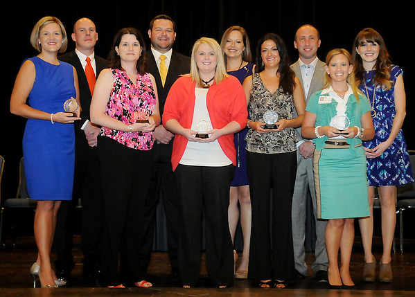 Enid Young Professionals announce their 2013 Top 10 Under 40 award winners during the 2nd annual banquet at Convention Hall Thursday, August 29, 2013. (Staff Photo by BONNIE VCULEK)