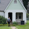 An Enid police officers work the scene of a homicide Saturday at 601 W. Maple. (Staff Photo by BILLY HEFTON)