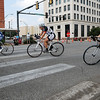 Competitors turn onto Randolph as they race around the square Saturday during the Twilight Criterium. (Staff Photo by BILLY HEFTON)