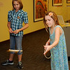 Haley Trybus (right), from Enid, plays a ring toss game during the Hands-On Circus History day at the Cherokee Strip Regional Heritage Center Saturday, August 3, 2013. (Staff Photo by BONNIE VCULEK)
