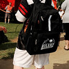 A boy wears the new backpack he received during the Feed the Neighborhood event Sunday at Government Springs Park. (Staff Photo by BILLY HEFTON)