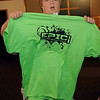 Tom Futo, from Ohio, holds his EPIC t-shirt that he received during the youth conference at Central Christian Church Monday, August 5, 2013. Enid Metropolitan Human Services Commission sponsored the event for the Youth Opportunity Task Force. (Staff Photo by BONNIE VCULEK)