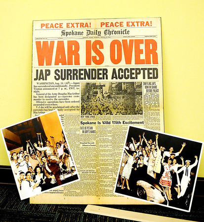 A Spokane Daily Chronicle newspaper and photographs record the excitement after Japan surrenders to end the War. (Staff Photo by BONNIE VCULEK)