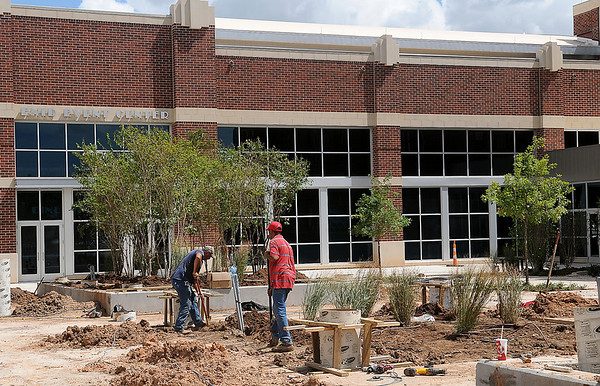 Landscaping near the west entrance of the Enid Event Center and the front of Convention Hall nears completion as workers install lighting and irrigation systems within the green space. (Staff Photo by BONNIE VCULEK)