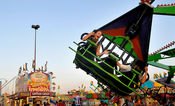 Carnival goers Wednesday at Wagner's Carnival in the Oakwood Mall parking lot. (Staff Photo by BILLY HEFTON)