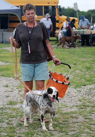 """A woman shops during """"Dog Days of Summer"""" at the Enid Farmers Market Saturday, August 3, 2013. (Staff Photo by BONNIE VCULEK)"""
