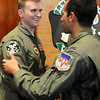 Jonathan Payne receives congratulations from a another pilot after the aircraft assignments for Class 13-13 at Vance Air Force Base Friday, August 2, 2013. (Staff Photo by BONNIE VCULEK)