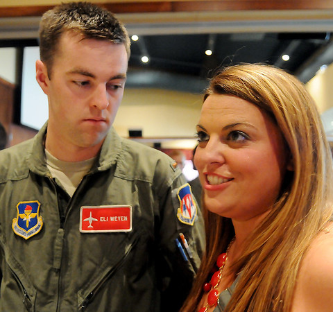 Abby Weyen discusses the difficulties she has faced while her husband, 2nd Lt. Eli Weyen, was stationed at Vance Air Force Base pilot training during assignment night for Class 13-13. (Staff Photo by BONNIE VCULEK)