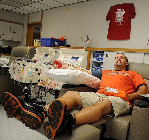 Scott Messenger supports the Oklahoma Blood Institute and Oklahoma State during the first day of OBI's Bedlam Blood Drive Friday, August 30, 2013. More than 70 registered as donors on National College Color Day. Those donating received their choice of an OU or OSU t-shirt and were entered into a drawing for two tickets to the OU-OSU bedlam football game in Stillwater on December 7, 2013. (Staff Photo by BONNIE VCULEK)