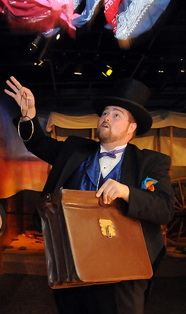 Circus ring master and magician, Cody Jolliff, entertains the crowd during the Hands-on History day at the Cherokee Strip Regional Heritage Center Saturday, August 3, 2013. (Staff Photo by BONNIE VCULEK)