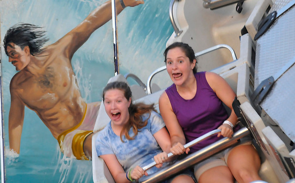 """Carnival goers make faces as they ride """"Wipeout"""" Wednesday at Wagner's Carnival in the Oakwood Mall parking lot. (Staff Photo by BILLY HEFTON)"""