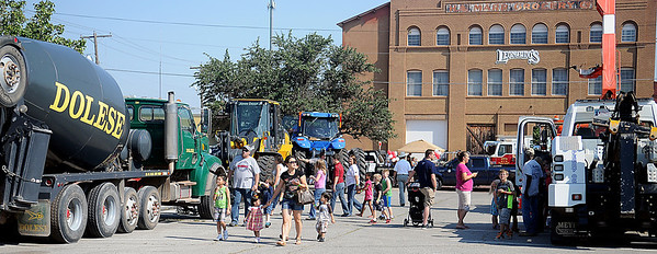 Parents and children enjoy the Leonardo's Discovery Warehouse Enid Mack Truck Motor Mania Saturday, August 24, 2013. More than 20 large truck were on static display during the event. (Staff Photo by BONNIE VCULEK)