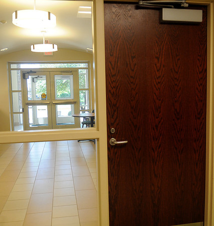 The new front entrance to Emerson Middle School features a series of double doors that lead into the building. All other exterior doors leading into the building are locked for students and staff safety each day. (Staff Photo by BONNIE VCULEK)