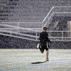 A boy runs across the turf at Selby Stadium during a rain storm early Friday morning as the Plainsmen tried to hold a midnight practice. (Staff Photo by BILLY HEFTON)