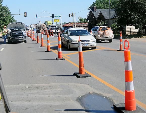 Traffic moves through a City of Enid Street and Traffic Public Service Division work zone Tuesday, August 27, 2013. Crews began the repair on a water line repair on Van Buren, between York and Indian. (Staff Photo by BONNIE VCULEK)