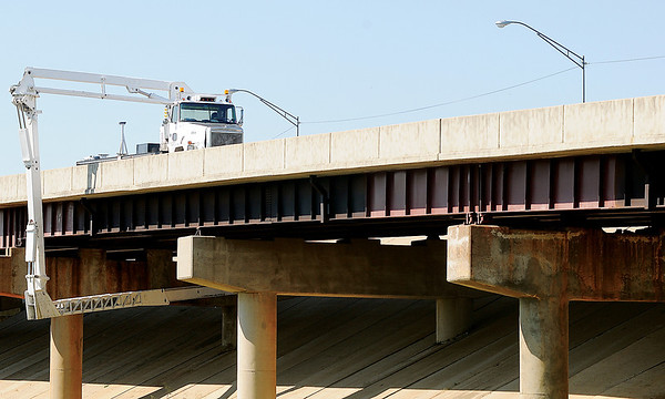Inspectors, from Infrastructure Engineers, employ the use of a heavy duty truck as they check the S. Van Buren overpass Tuesday, August 27, 2013. The Oklahoma Department of Transportation (O.D.O.T.) requested that the Oklahoma City based company conduct bridge inspections for the next few weeks. A flashing arrow directed northbound traffic into the left lane as drivers neared the work zone. (Staff Photo by BONNIE VCULEK)