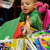 Braylon Perosi drops a box of crayons into a bin in his pre-kindergarten class during Meet the Teacher night at Monroe Elementary Monday. (Staff Photo by BILLY HEFTON)