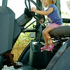 Molly Peters sits inside the cab of one of the heavy equipment vehicles during Enid Mack Motor Mania at Leonardo's Children's Museum Saturday, August 23, 2014. (Staff Photo by BONNIE VCULEK)