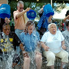 """Individuals react during their ALS Ice Bucket Challenge issued by United Way at The Non-profit Center Friday, August 22, 2014. Proceeds from the event fund ALS research, often referred to as """"Lou Gehrig's Disease"""". (Staff Photo by BONNIE VCULEK)"""
