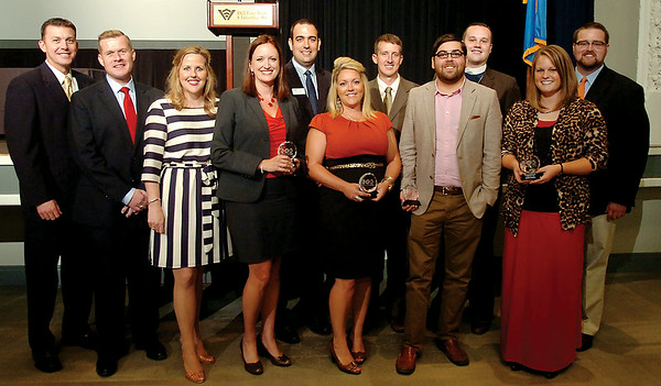 Featured speaker Louisa McCune-Elmore (third from left) appears in a portrait with the 2014 Enid Young Professionals' 10-Under 40 award recipients (from left) Kaleb Hennigh, Shaun Cummings, Jessica Caruthers, Keller Taylor, Christy Baker, Jay Bowers, Ben Ezzell, Rev. Andrew Long, Stephanie Randolph and Cody Jolliff. The winners were selected from 27 outstanding nominees, and the winners were announced during a luncheon at the Enid Event Center and Convention Hall Grand Ballroom Thursday, August 28, 2014. (Staff Photo by BONNIE VCULEK)