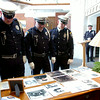 """Enid Police Officers pause in the lobby as they honor Retired Capt. Glenn """"Red"""" Willard Harmon during a Celebration of Life for Harmon at the First Baptist Church Tuesday, August 26, 2014. (Staff Photo by BONNIE VCULEK)"""