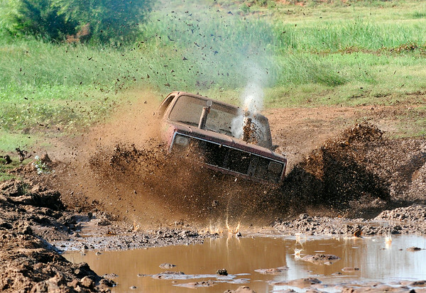 A competitor makes a splash as he starts his run during Molly Mayhem's Mud Bog Saturday August 9 in Hennessey. (Staff Photo by BILLY HEFTON)