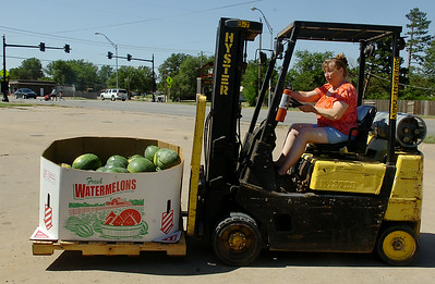 Gaye Cantellay, with Cantellay's Produce on S. Van Buren, moves a bin of red and yellow diamond watermelons Saturday, August 30, 2014. (Staff Photo by BONNIE VCULEK)