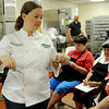 Tiffany Poe, a chef and educator from Cooking for Kids, passes out samples of romaine lettuce during a taste test at Enid Public Schools' Central Kitchen Thursday, August 14, 2014. The two-day seminar provides training for nutritional professionals. (Staff Photo by BONNIE VCULEK)