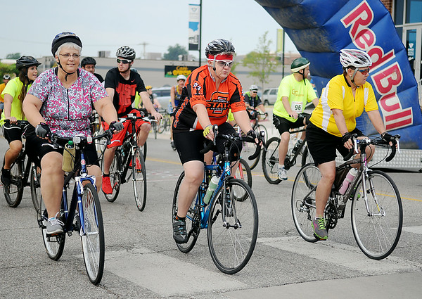Lady riders participate during the 9th annual AMBUCS Tour de Trykes at David Allen Memorial Ballpark Saturday, August 16, 2014. The courses ranged from 2, 14, 26, and 42 miles or a 100k race. More than 400 bicyclists registered for the ride that raises money for local AMBUCS projects. (Staff Photo by BONNIE VCULEK)