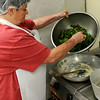 Carol McClaren, a child nutrition professional for Enid Public Schools,  prepares a sauteed Swiss chard and quinoa medley during the Cooking for Kids seminar at Central Kitchen Friday, August 15, 2014. (Staff Photo by BONNIE VCULEK)
