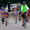 Enid Police Chief Brian O'Rourke (front right) pedals east on Randolph with other riders during the 9th annual AMBUCS Tour de Trykes Saturday, August 16, 2014. The courses ranged from 2, 14, 26, and 42 miles or a 100k race. More than 400 bicyclists registered for the ride that raises money for local AMBUCS projects. (Staff Photo by BONNIE VCULEK)