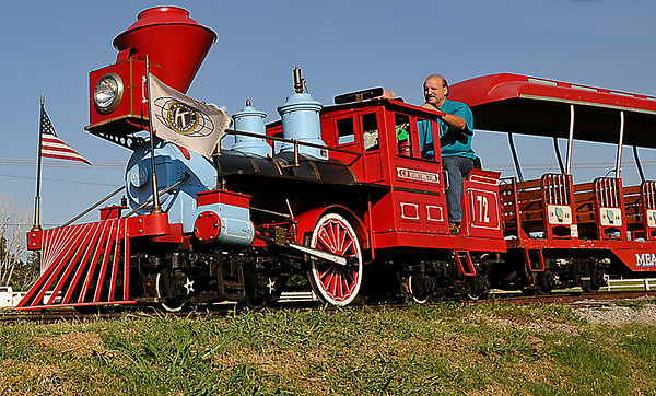 Melvin Key drives the Kiwanis train around Meadowlake Park Thursday. The club operates the train 6:00 p.m. to 9:00 p.m. Thursday - Sunday. (Staff Photo by BILLY HEFTON)