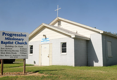 Progressive Missionary Baptist Church moved to the new location on the corner of 12th and Ash. Even though a fire hydrant was located on the northwest corner of the intersection, the city of Enid said the church would have to pay for a new water line installation from the east if the congregation wanted to build a new sanctuary. However, the water flow was re-tested and now the church may expand when funds are available. (Staff Photo by BONNIE VCULEK)