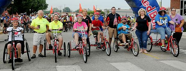 AmTryke riders begin the 9th annual AMBUCS Tour de Trykes Saturday, August 16, 2014. (Staff Photo by BONNIE VCULEK)