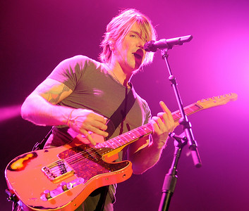 Goo Goo Dolls' guitarist and vocalist John Rzeznik performs to a sell-out crowd at the Enid Event Center during the American Rock Band's summer tour with Daughtry in Enid, Okla. Tuesday, August 05, 2014. The group, which formed in 1986 in Buffalo, New York, have had 14 top ten singles on various charts and have sold more than 10 million albums worldwide. (Staff Photo by BONNIE VCULEK)