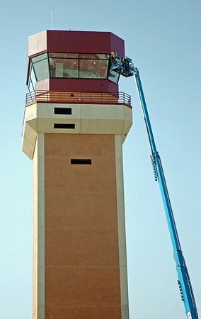 Workers complete the exterior trim on the top of the new control tower at Vance Air Force Base Wednesday, August 20, 2014. (Staff Photo by BONNIE VCULEK)