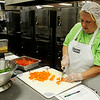 Tammy O'Neal prepares ingredients for a salad during the Cooking for Kids seminar at Enid Public Schools' Central Kitchen Friday, August 15, 2014. (Staff Photo by BONNIE VCULEK)
