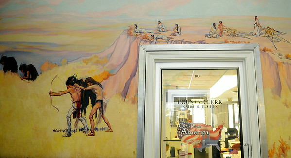 """Ruth Monro Augur's No. 1 mural """"The Hunter's Trail"""" illustrates how Indians stalked buffalo before they possessed horses as the tribal women watched from the cliffs above the hunting grounds. The mural is located on the north wall of the west entrance to the Garfield County Courthouse. (Staff Photo by BONNIE VCULEK)"""